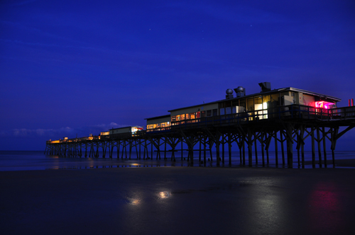 Free Picture: Photo of the Sunglow Pier lit up just after dusk with twinkling stars and a deep blue sky in Daytona Beach, FL.