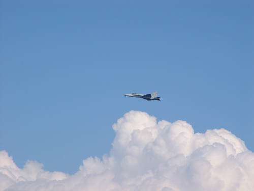 Free Picture: Photo of the side view of an F/A-18 Hornet fighter jet in the sky among the clouds.