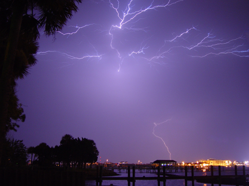 Free Picture: Photo of a bright bolt of lightning striking over the river in Daytona Beach, Florida.