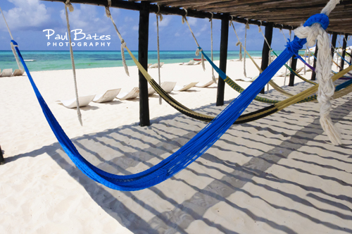 Free Picture: Photo of empty colorful hammocks waiting for visitors to enjoy under a shady pergola on the beach in Cozumel, Mexico.