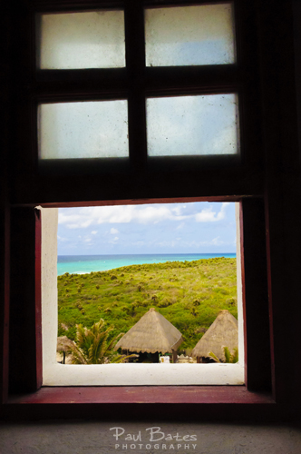 Free Picture: Photo of the view through a window from the Faro de Celerain lighthouse which marks the southernmost point in Cozumel, Mexico which has beautiful views even on the way up the stairs to the of the observation deck.