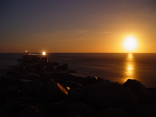 Free Picture: Photo of a night moonrise over the Ponce Inlet Jetty in the Atlantic Ocean.