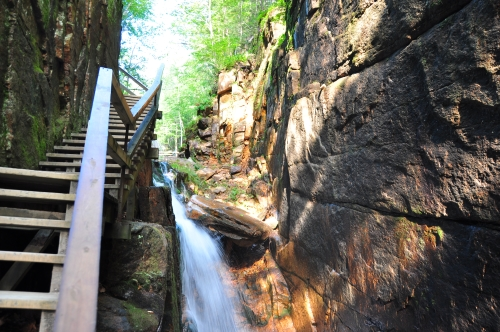 Free Picture: Photo of a wooden walkway ascending on the side of a rock face near a waterfall at Flume Gorge, Franconia State Park.