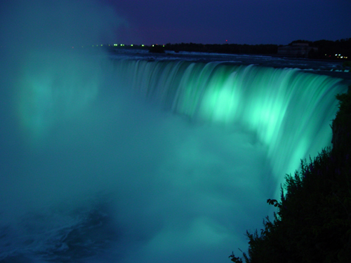 Free Picture: Photo of Horseshoe Falls at night bathed in glowing aqua light at Niagara Falls.