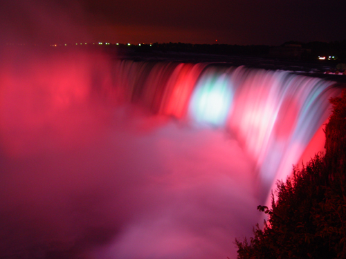 Free Picture: Photo of Horseshoe Falls at Niagara Falls illuminated with red and blue spotlights.
