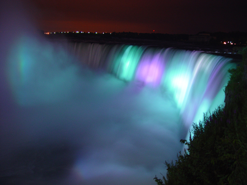 Free Picture: Photo of Niagara Falls lit up at night in purple and aqua in the summer taken from the Ontario, Canada side.