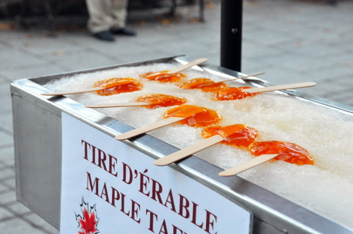 Free Picture: Photo of maple taffy also called tire d'erable by Canadians poured onto man made snow and then wrapped around popsicle sticks to be enjoyed by kids of all ages.