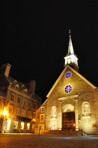 Free Picture: Photo of Notre Dame des Victoires church in Vieux Quebec or Old Quebec glowing at night.