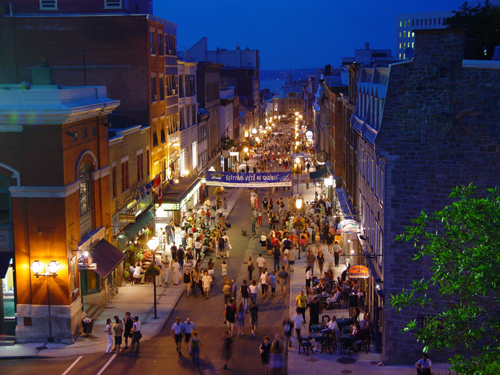 Free Picture: Photo of Rue Saint-Jean after sunset during the Quebec City Summer Festival.