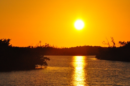 Free Picture: Photo of the view from the wooden walkway across part of Old Blind Pass of a Sanibel Island Sunset.