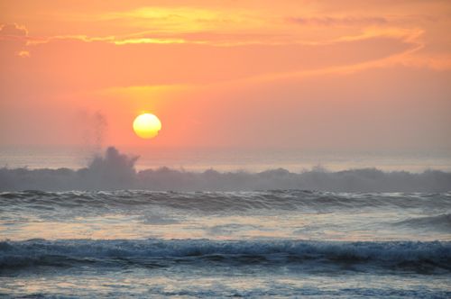 Free Picture: Photo of ocean waves splashing into the salty air during a pretty sunrise.