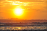 Free Photo of Vibrant Orange Sunrise Ocean Spray